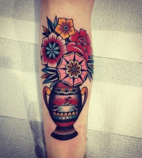 Colorful flowers tattoo by Kirk Jones