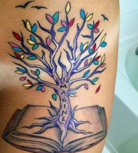Colorful tree and book tattoo