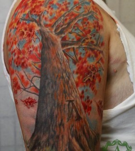 Colorful tree tattoo by Sean Ambrose