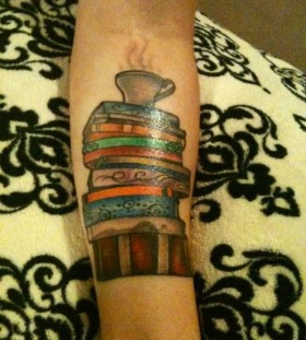 Cup and books tattoo