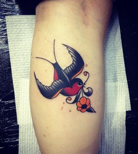 Cute bird tattoo by Kirk Jones