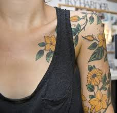 Cute yellow flowers tattoo
