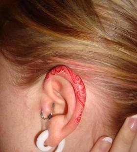 Ear red tattoo