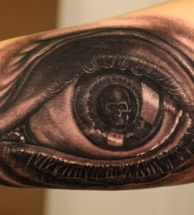 Eyes and skull tattoo by Andy Engel