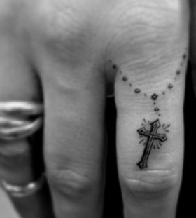 Finger cross religious tattoo