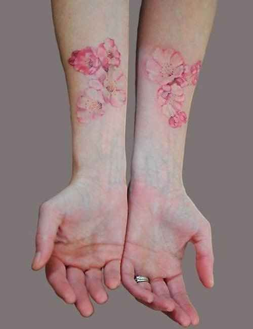 Flowers on arm pink tattoo