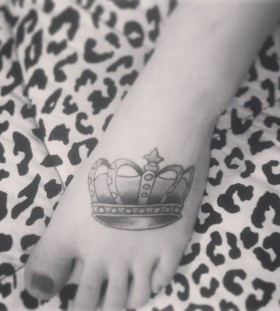 Foot black and white crown tattoo