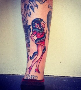 Girl and snake tattoo by Kirk Jones
