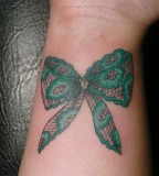Green bow lace tattoo