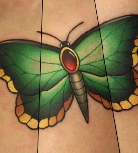 Green butterfly tattoo by Michelle Maddison