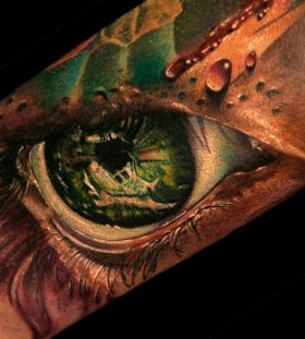 Green eyes tattoo by Andy Engel