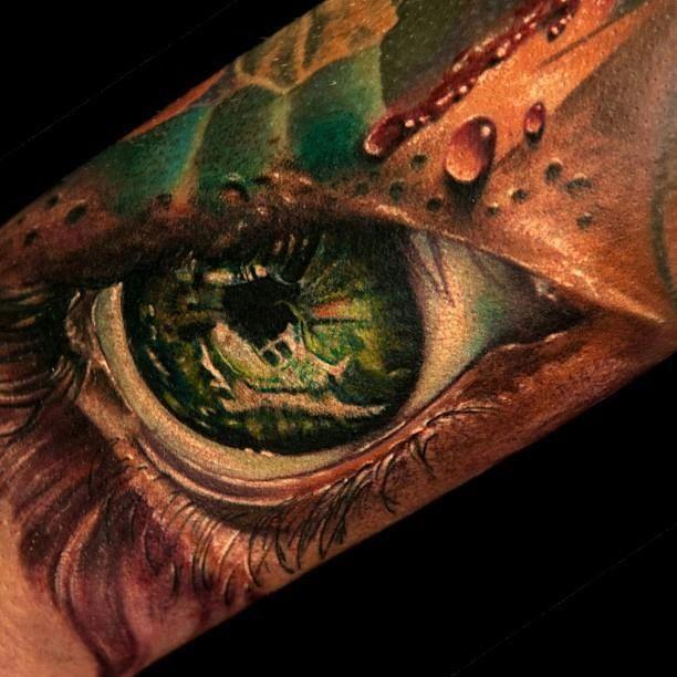 Green eyes tattoo by Andy Engel