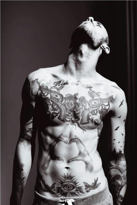 Gun heart and eye man tattoo
