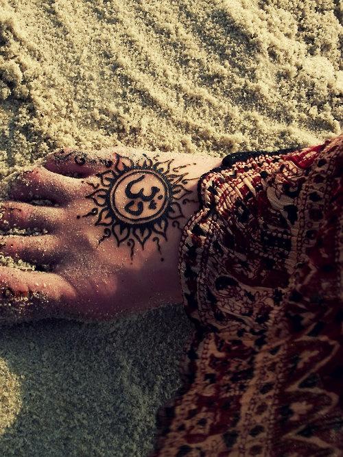 Heart and sun tattoo