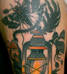 Lamp and bird tattoo