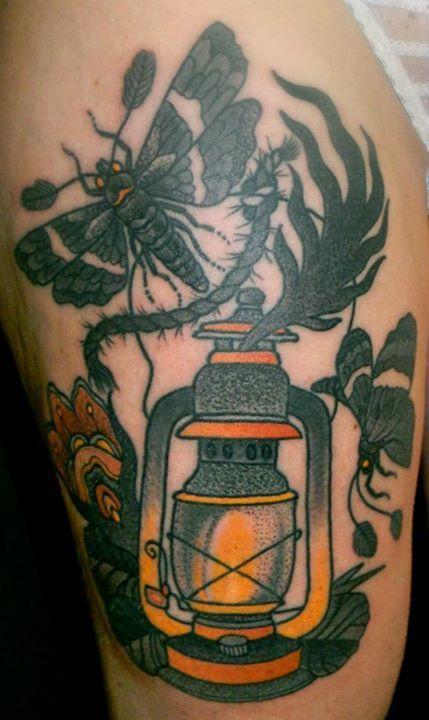 Lamp and bird tattoo