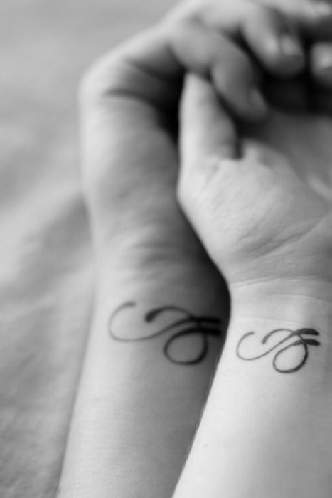 Letter couples tattoo