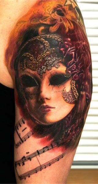 Masks tattoo by Andy Engel