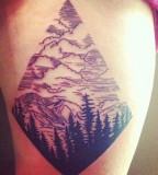 Mountains and tree tattoo