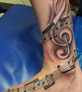 Music tattoo by Andy Engel