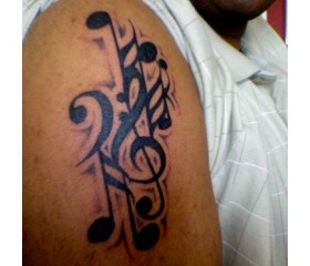 Music tattoo by Duane