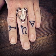 Ornaments fingers tattoo