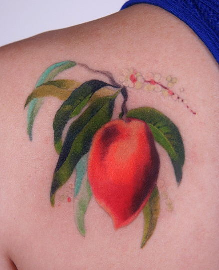 Peach on branch tattoo by Amanda Wachob