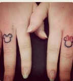 Pretty disney tattoo on fingers