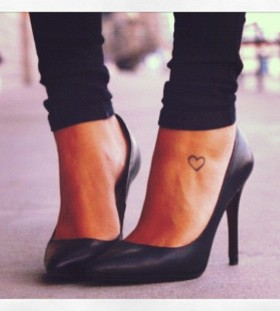 Pretty heart woman tattoo