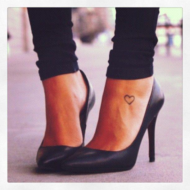 Pretty heart woman tattoo