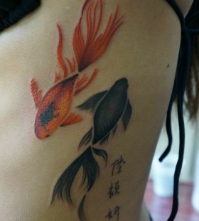 Red and black fish tattoo