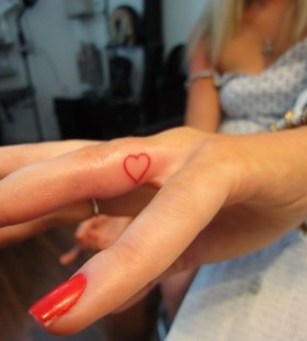 Red finger tattoo
