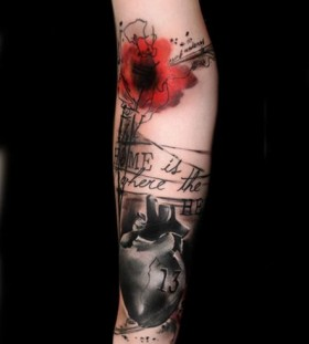 Red flower tattoo by Volko Merschky