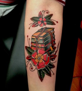 Red flowers and book tattoo