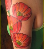 Red flowers tattoo