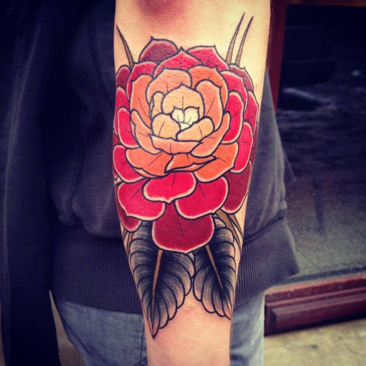 Red flowers tattoo by Aivaras Lee