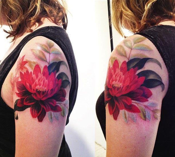 Red flowers tattoo by Amanda Wachob