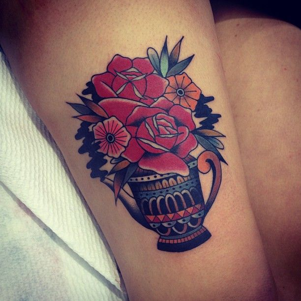 Red flowers tattoo by Kirk Jones