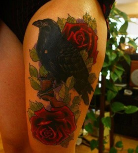Red rose and crow woman tattoo