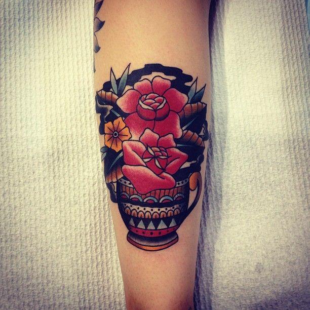 Red tattoo by Kirk Jones