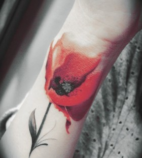 Red watercolor tattoo