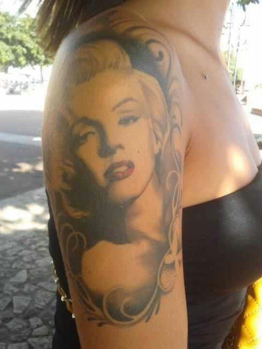 Shoulder tattoo with Marilyn Monroe
