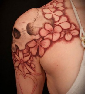 Skull and flowers red tattoo