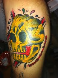 Skull yellow tattoo