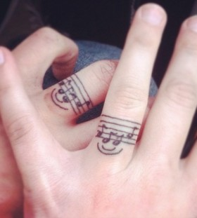 Smile and fingers music tattoo