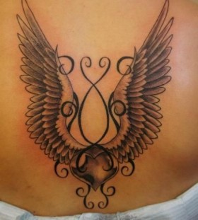 Wings from ornaments tattoo