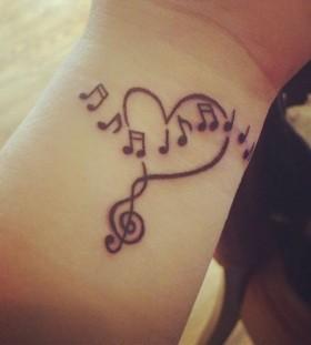 Wrist heart and music tattoo