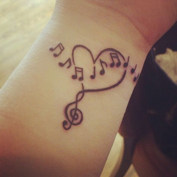 Wrist heart and music tattoo