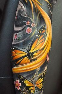 Yellow butterflies tattoo