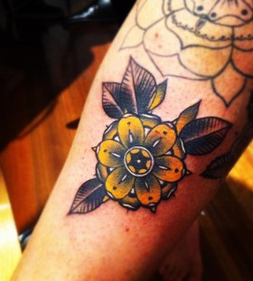 Yellow flower tattoo by Pari Corbitt